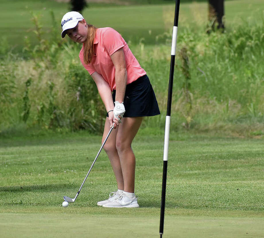 Riley Lewis hits her chip shot onto the green during her round Tuesday at Spencer T. Olin Golf Course. Photo: Matt Kamp|The Intelligencer