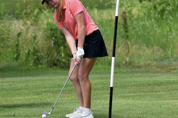 Riley Lewis hits her chip shot onto the green during her round Tuesday at Spencer T. Olin Golf Course.