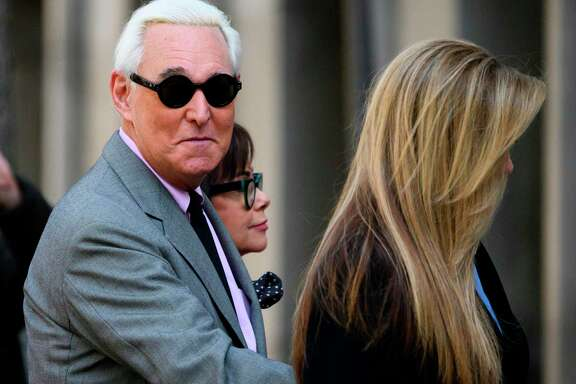 Roger Stone, former adviser to U.S. President Donald Trump, enters the E. Barrett Prettyman United States Court House with his wife Nydia (C) and daughter Adria Stone(R) in Washington, DC. - US President Donald Trump communted the 40-month prison sentence of longtime ally Roger Stone on Friday, the White House said.  A reader makes the distinction between criminals in America.