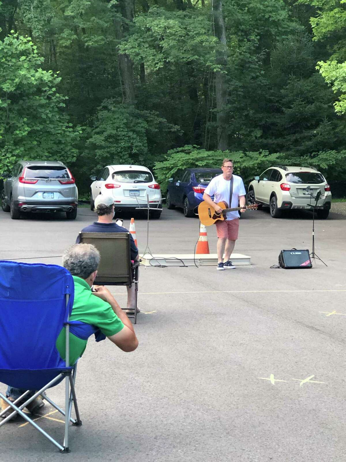 Thursday evening open mic nights have returned to the JCC in Sherman, with social distancing for everyone's safety. Sherman First Selectman Don Lowe is seen here during a recent performance.