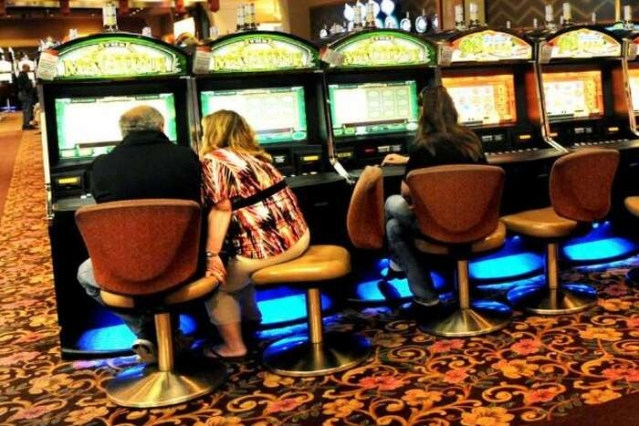 Gamers play the video slot machines on Tuesday, May 28, 2013, at Saratoga Casino and Raceway in Saratoga Springs, N.Y.