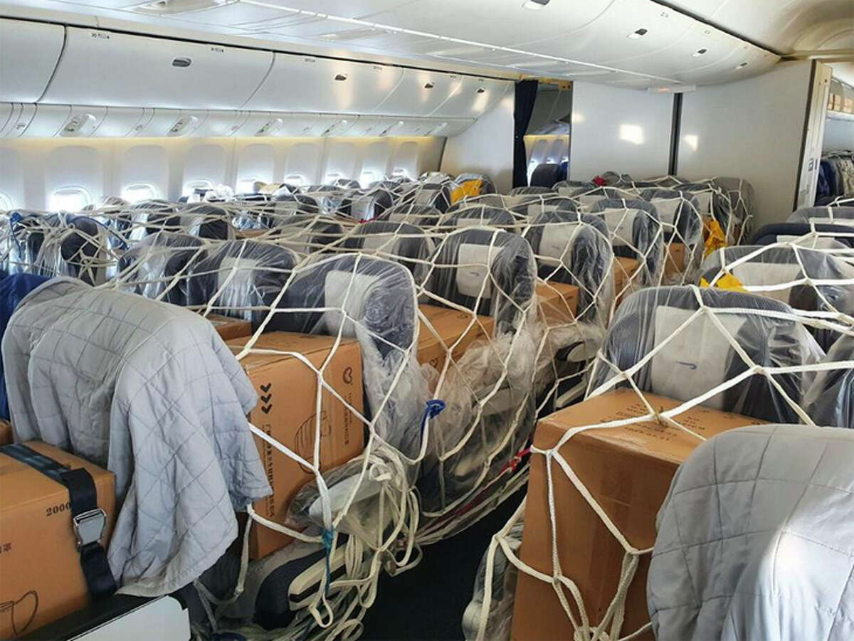 Cargo is strapped into the seats of a British Airways wide-body aircraft.
