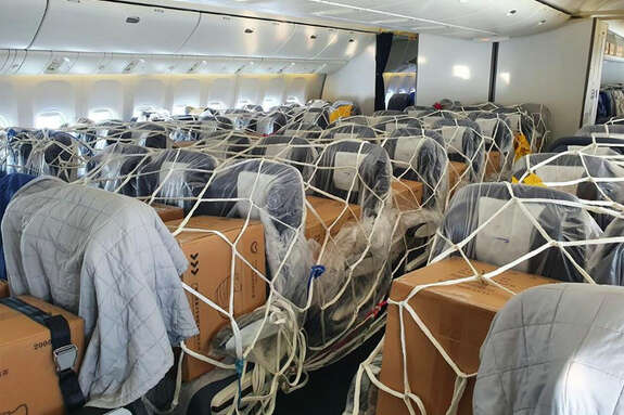 Cargo strapped into the seats of a British Airways widebody.