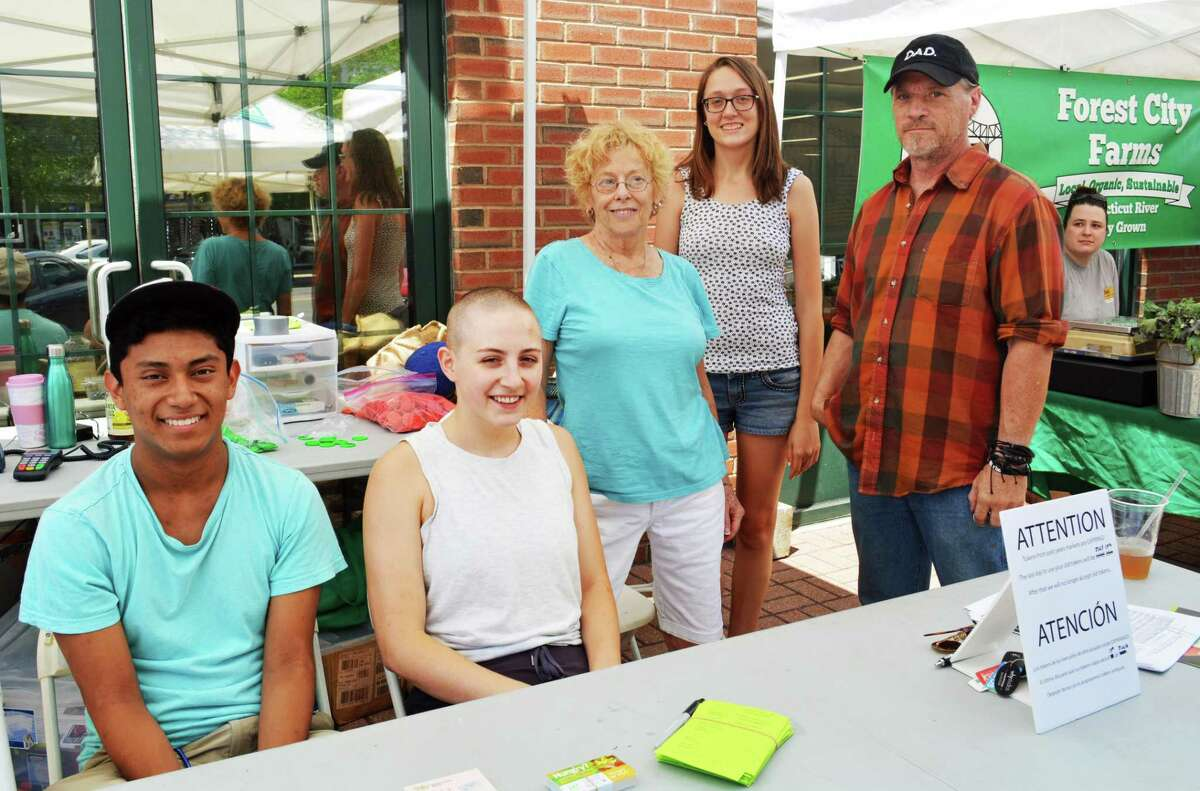 This photo of volunteers from last year's North End Farmers Market includes Paige Petit, second from left, the new market master at the revamped Middletown Farmers Market, which is moving to the South Green for Friday's opening day.