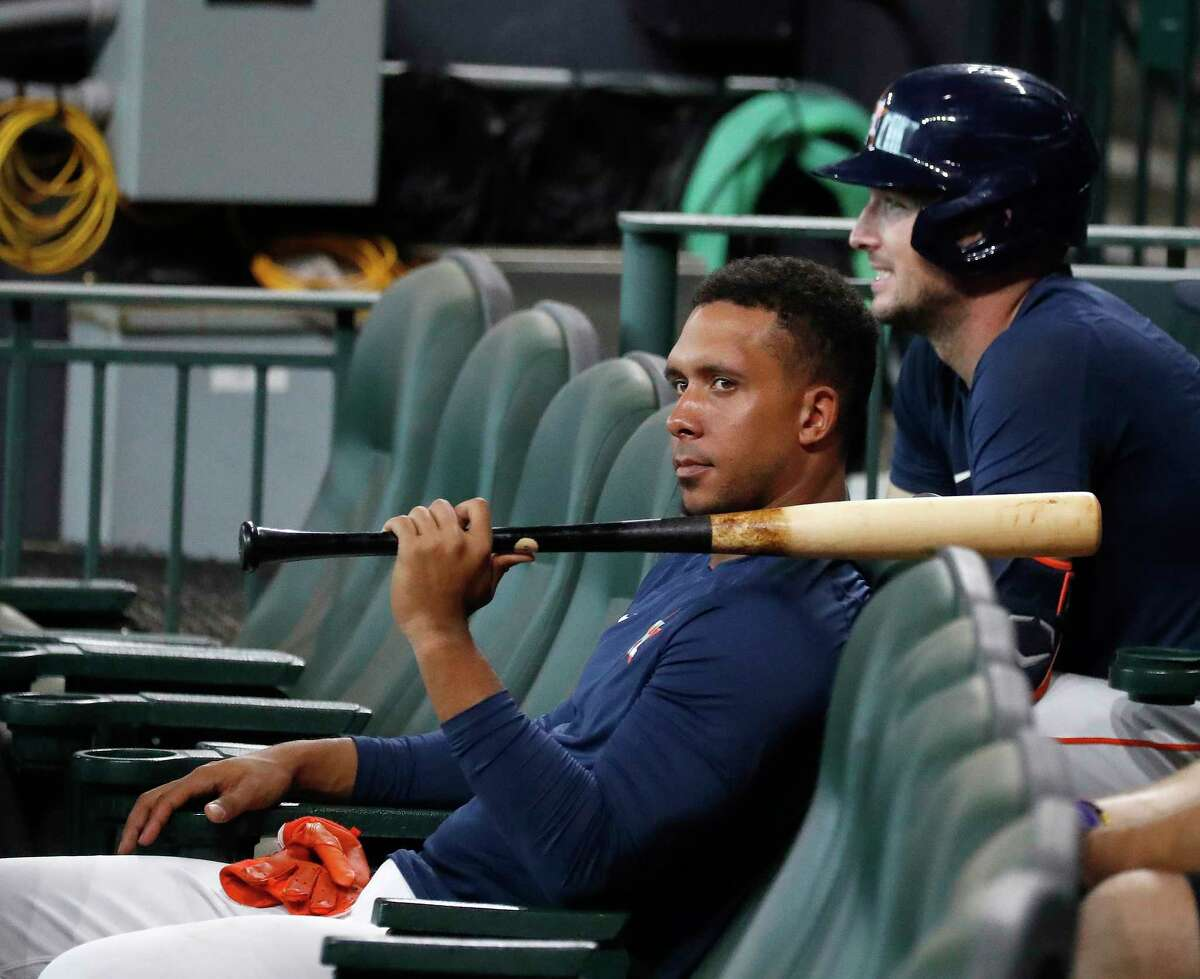 Houston Astros Michael Brantley and Alex Bregman sit in the Diamond Club seats during a live batting practice during the Astros summer camp at Minute Maid Park, Wednesday, July 15, 2020, in Houston.