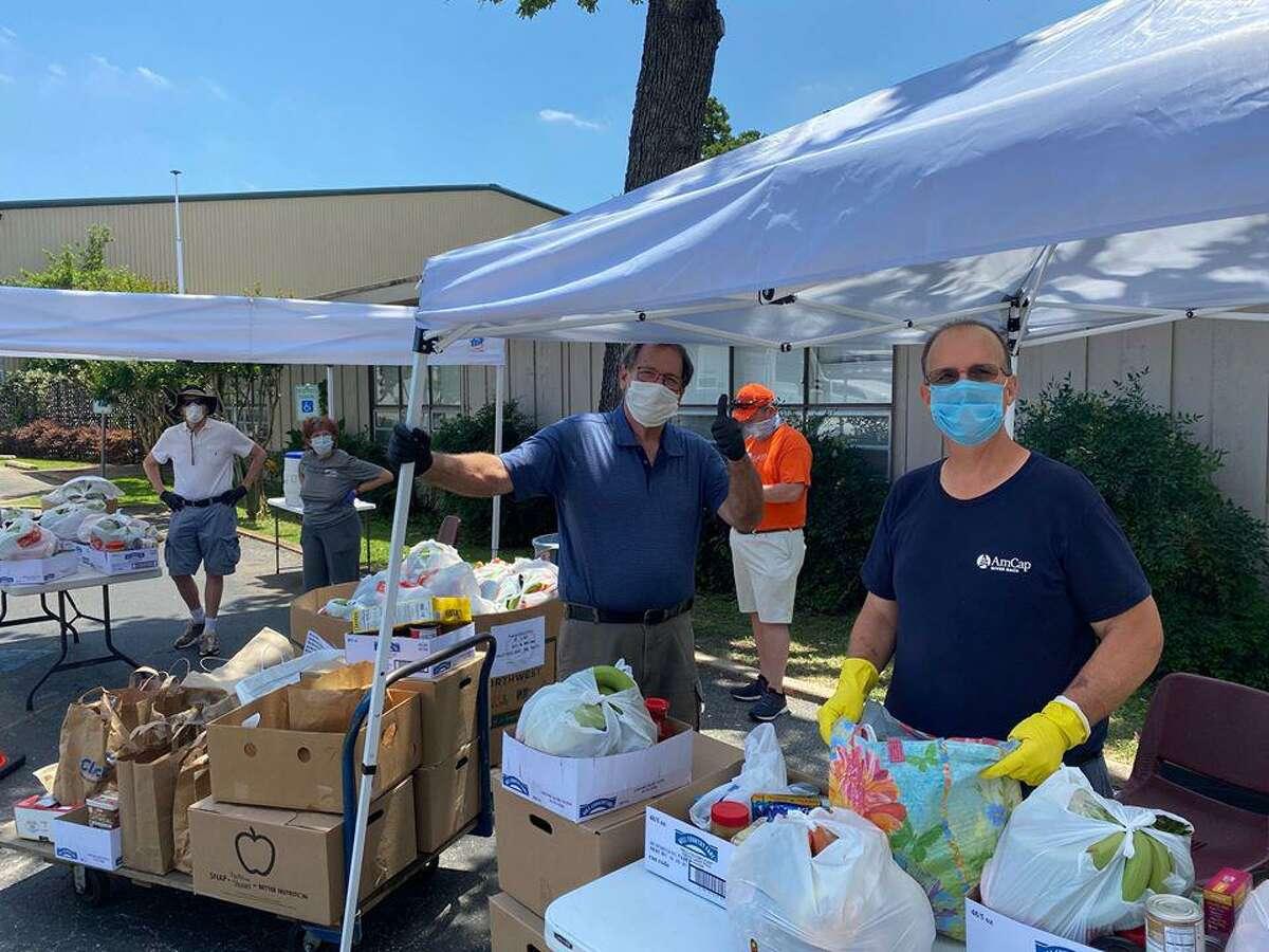 Volunteers at Fair Haven Food Pantry at Chapelwood United Methodist Church is Spring Branch help distribute food