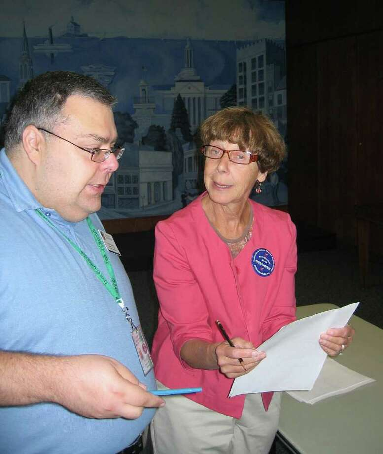 Republican Registrar of Voters Fred DeCaro III answers questions from Ellen McBride, a volunteer post-election observer from the Connecticut Citizen Election Audit Coalition, Wednesday at Town Hall. The state-mandated audit showed no major irregularities in the Aug. 10 primary results from Riverside School. Photo: Neil Vigdor, File Photo / Greenwich Time File Photo