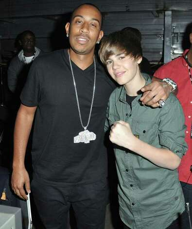 Rapper Ludacris, left, and singer Justin Bieber pose backstage at the SOS Saving Ourselves Help for Haiti benefit presented by BET Networks at American Airlines Arena, Friday, Feb. 5, 2010, in Miami. Proceeds of the telecast will go to four charitable organizations - Y?le Haiti, CARE, Project Medishare and Children's Safe Drinking Water. (Photo by Manny Hernandez/PictureGroup for BET) Photo: Manny Hernandez / MICPI