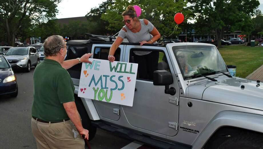 Former patients gift Gary Wanerka with a heartfelt sign. Photo: Bill O'Brien /