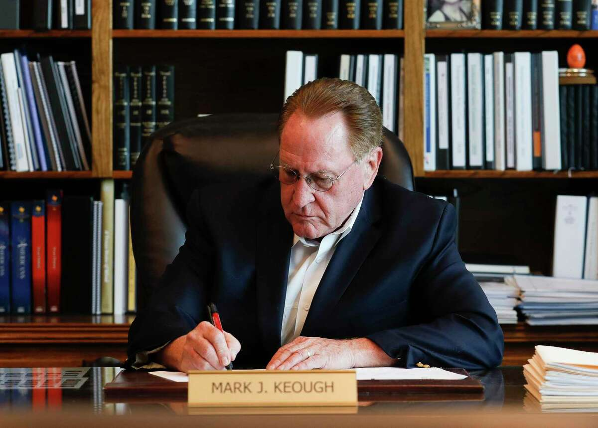 Montgomery County Judge Mark Keough works at his desk in his office in July. Keough turned himself into the Montgomery County Jail Wednesday morning and was booked on a driving while intoxicated charge related to a sleep aid found in his blood following a September car crash.