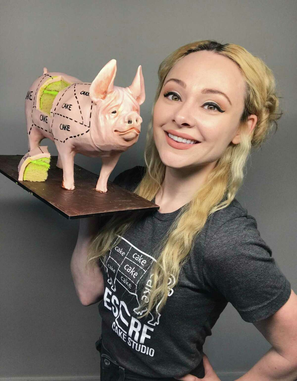 This is actually Natalie Sideserf of Sideserf Cake Studio, and not a cake. Oh, the pig on the left? Yes, that's definitely a cake.