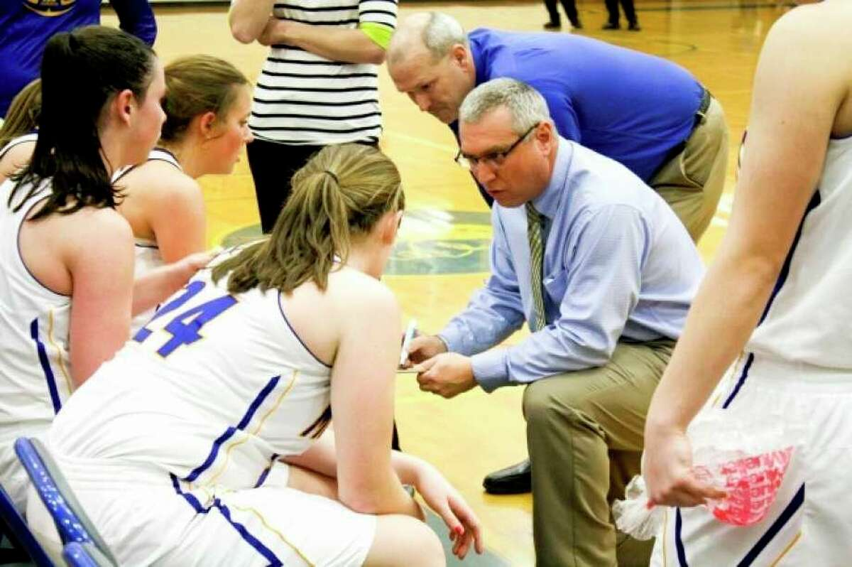 In 2012, Bob Raven coached the Morley Stanwood girls' basketball team to a perfect record and a state championship. (Pioneer file photo)