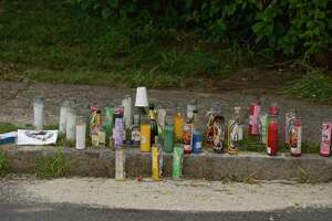 A memorial has been set up at the scene of Sunday's fatal shooting on Beaver Street. Wednesday, July 15, 2020, in Danbury, Conn.