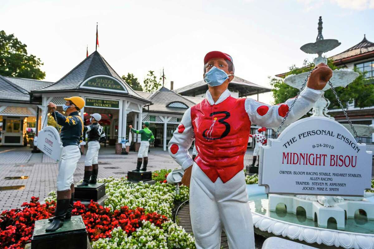 Even the lawn jockeys wear their masks are maintain social distancing outside the Clubhouse the day before opening day at Saratoga Race Course July 15, 2020 in Saratoga Springs, N.Y. Photo by Skip Dickstein/Special to the Times Union.