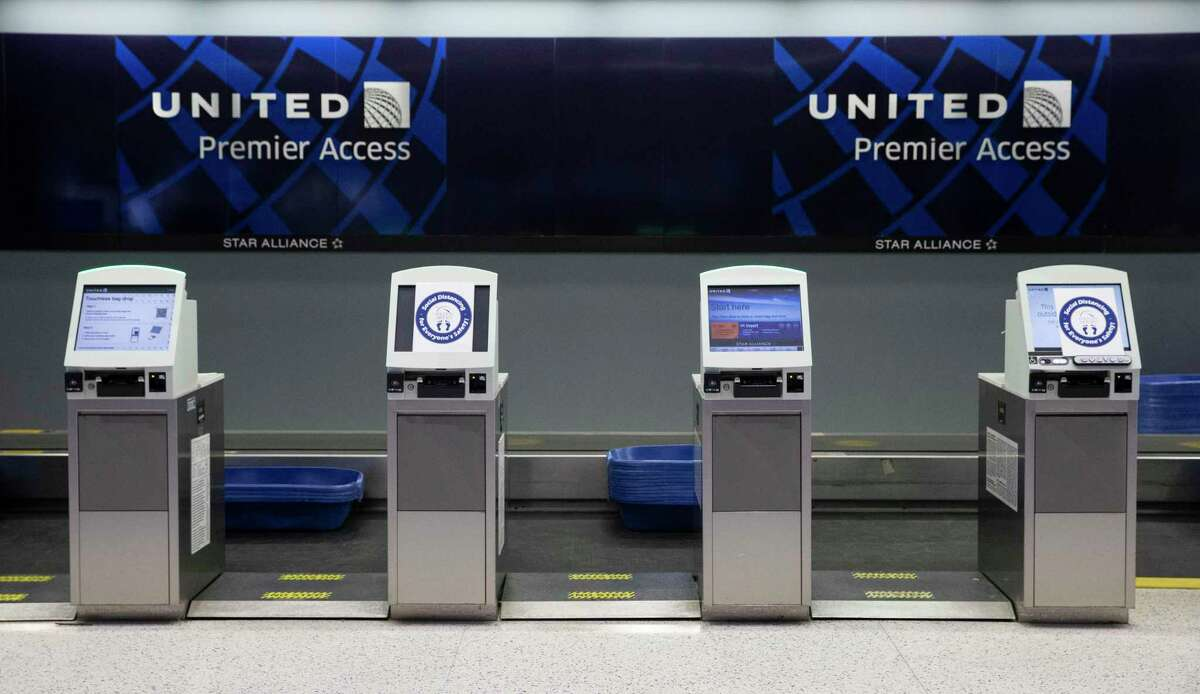 United Airlines opens every other self check-in kiosk to keep passengers maintain social distancing while checking in at the lobby Tuesday, July 7, 2020, at George Bush Intercontinental Airport in Houston.