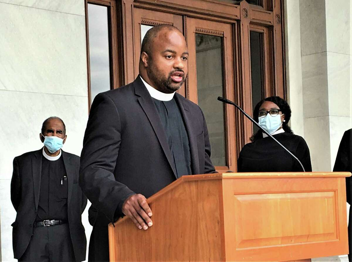The Rev. Stephen A. Cousin Jr., pastor of the Bethel A.M.E. Church in New Haven, at the State Capitol on Wednesday, in support of a police reform bill to be considered in a special session of the legislature.