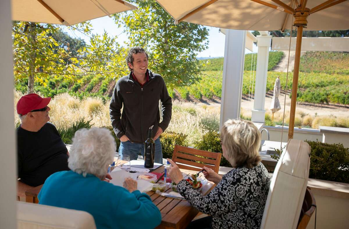 Sommelier Gregory McDonald talks with wine lovers at Justin Winery in 2018 in Paso Robles, California.