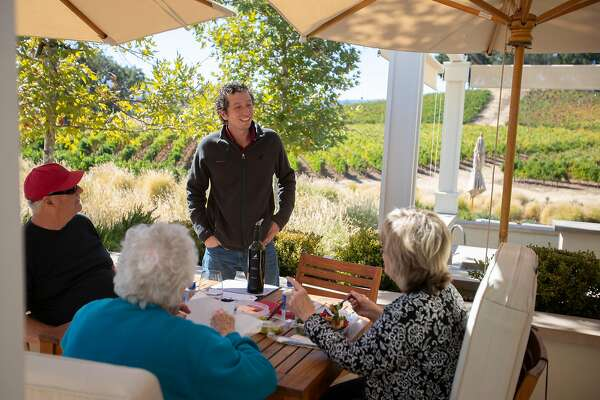 Sommelier Gregory McDonald talks with wine-lovers at Justin Winery on Wednesday, 10/24, 2018 in Paso Robles, California.