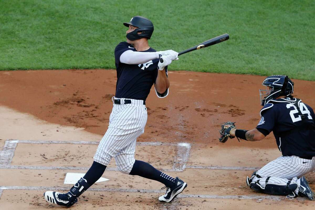 New York Yankees' Aaron Judge follows through on a solo home run off James Paxton during an intrasquad game aWednesday, July 15, 2020, at Yankee Stadium in New Yo, Yankees catcher Gary Sanchez is behind the plate. (AP Photo/Kathy Willens)