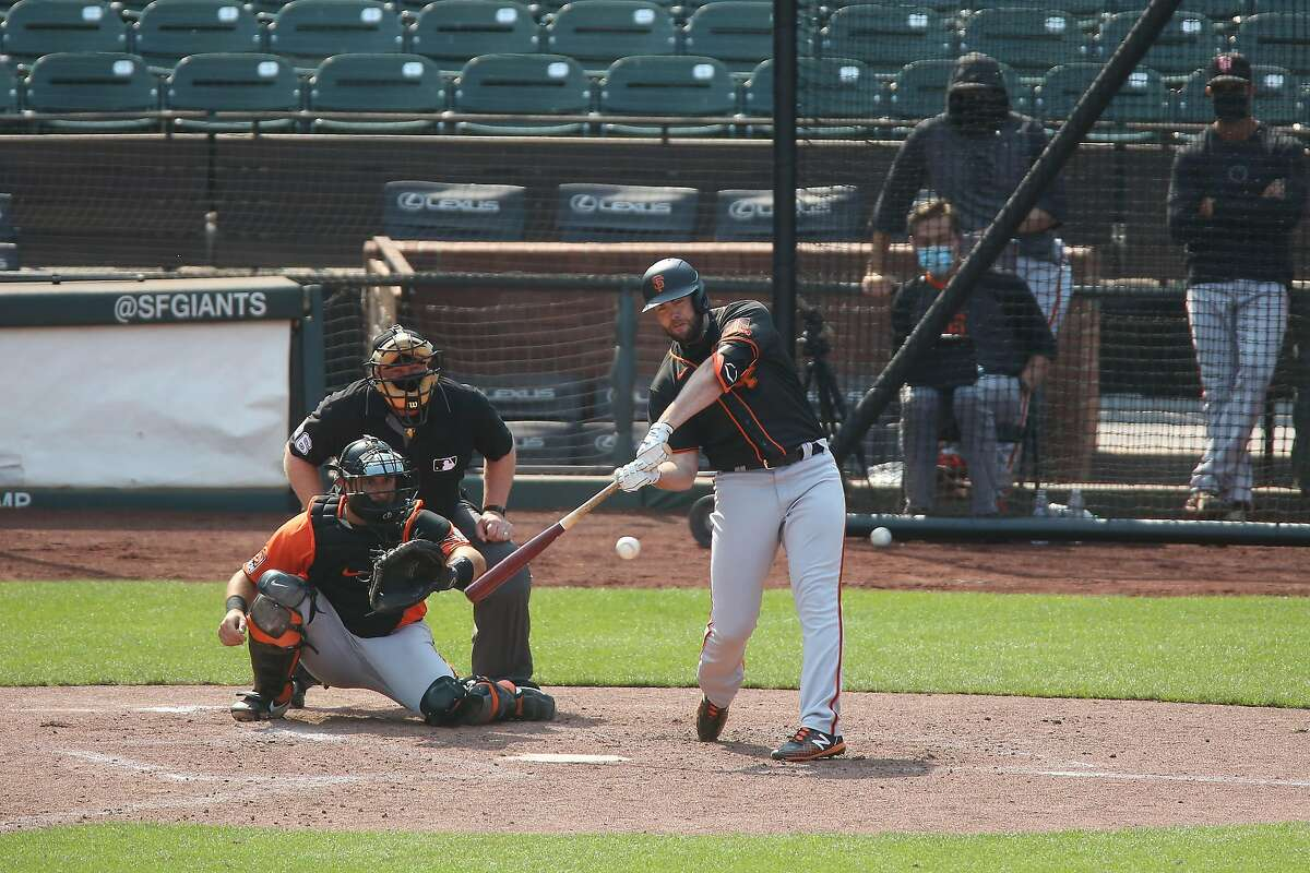 Darin Ruf #33 of the San Francisco Giants hits the ball during an inter squad game at Oracle Park on Wednesday, July 15, 2020 in San Francisco, Calif.