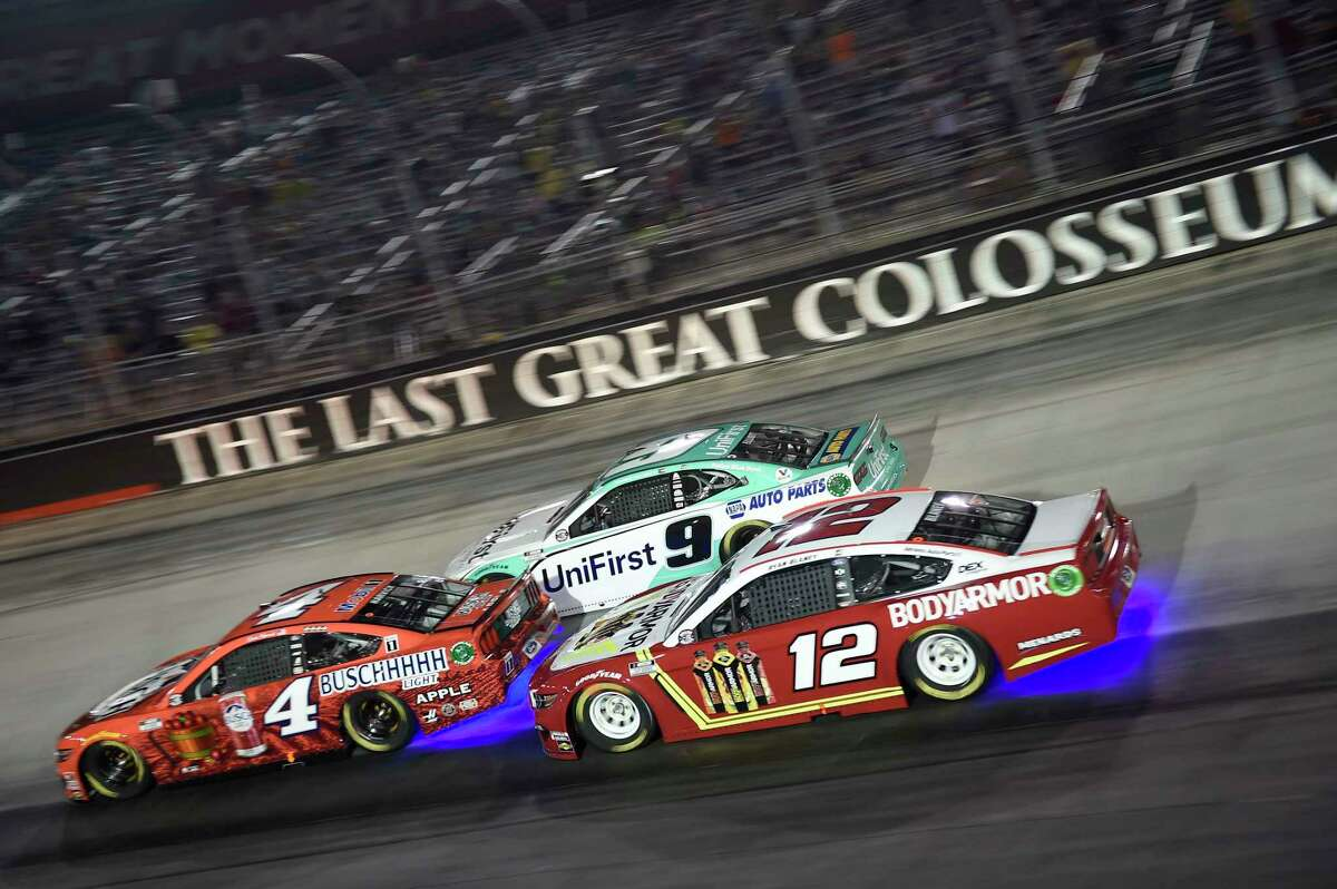 BRISTOL, TENNESSEE - JULY 15: Kevin Harvick, driver of the #4 Busch Light Apple Ford, Chase Elliott, driver of the #9 UniFirst Chevrolet, and Ryan Blaney, driver of the #12 BodyArmor Ford, race during the NASCAR Cup Series All-Star Race at Bristol Motor Speedway on July 15, 2020 in Bristol, Tennessee. (Photo by Jared C. Tilton/Getty Images)