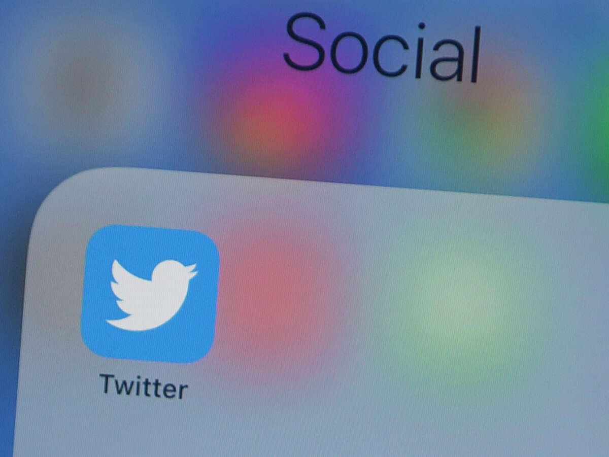 (FILES) In this file photo taken on July 10, 2019, the Twitter logo is seen on a phone in this photo illustration in Washington, DC. - The official Twitter accounts of Apple, Elon Musk, Jeff Bezos and others were hijacked on Wednesday by scammers trying to dupe people into sending cryptocurrency bitcoin in the hope of doubling their money. (Photo by Alastair Pike / AFP) (Photo by ALASTAIR PIKE/AFP via Getty Images)