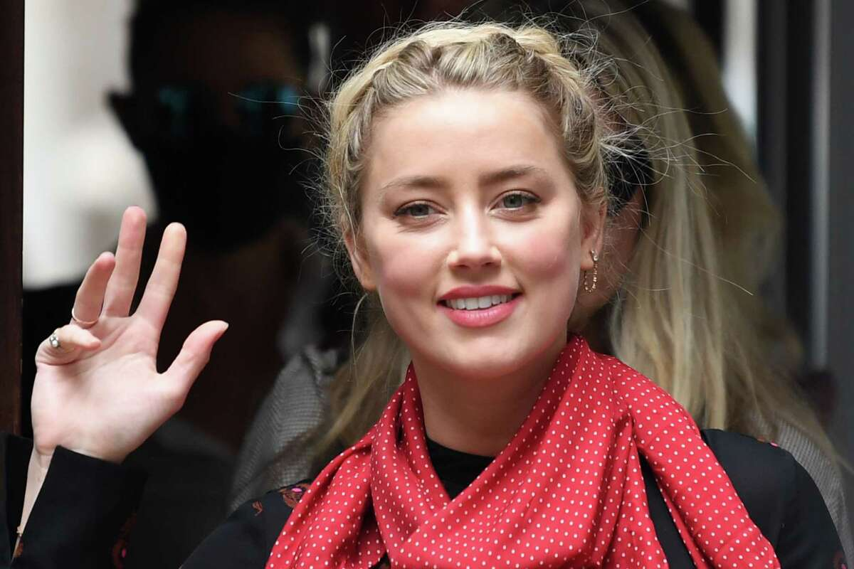 US actress Amber Heard arrives on the seventh day of the libel trial by her former husband US actor Johnny Depp against News Group Newspapers (NGN), at the High Court in London, on July 15, 2020. - Depp is suing the publishers of The Sun and the author of the article for the claims that called him a