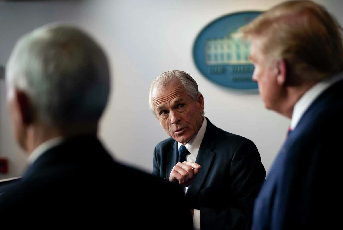White House trade adviser Peter Navarro, who is now serving as national defense production act policy coordinator, gestures while addressing a news conference about the coronavirus response with President Donald Trump, and Vice President Mike Pence, at the White House in Washington, Thursday, April 2, 2020. As the United States races to secure supplies to fight the coronavirus, the presidenta€™s trade adviser has been handed expansive authority over the firmsa€™ global supply chains. (Doug Mills/The New York Times)