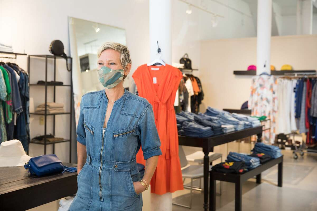 DISH owner Desiree Alexander stands inside her womenswear store.  She has decided not to use a PPP loan and is closing her store in Hayes Valley.
