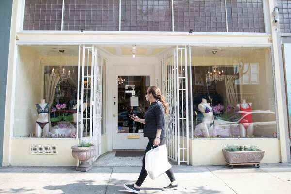 A pedestrian walks by Alla Prima Lingerie. It was one of the businesses that received a PPP loan in the Hayes Valley neighborhood in San Francisco, Calif. on July 15, 2020.