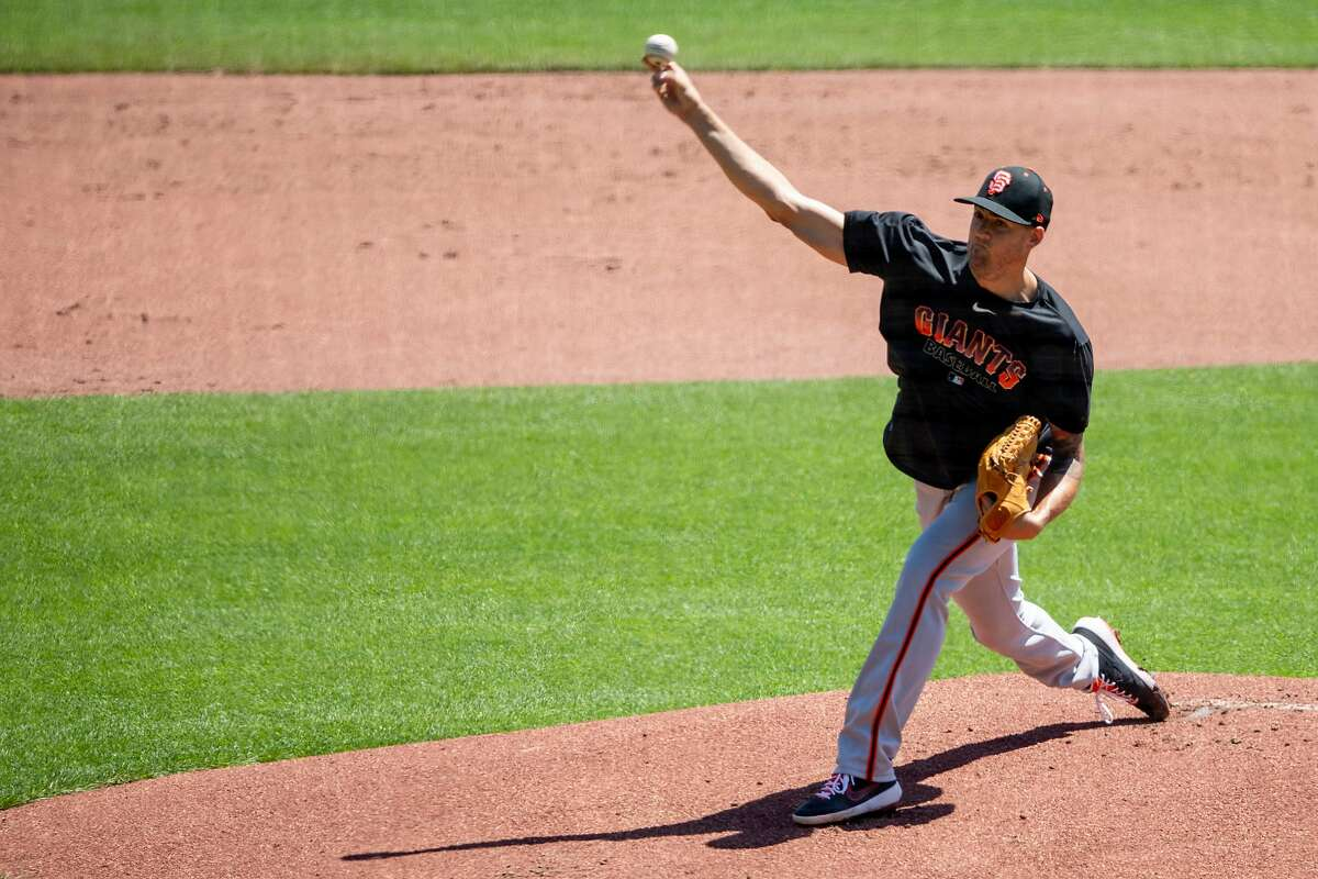 San Francisco Giants pitcher Kevin Gausman (#34) works on drills during the San Francisco Giants' summer training camp session at Oracle Park in San Francisco, Calif. Saturday, July 4, 2020. Due to COVID-19, the 2020 MLB season has been postponed with players just beginning to return for warmups and practices while wearing masks and keeping social distance.