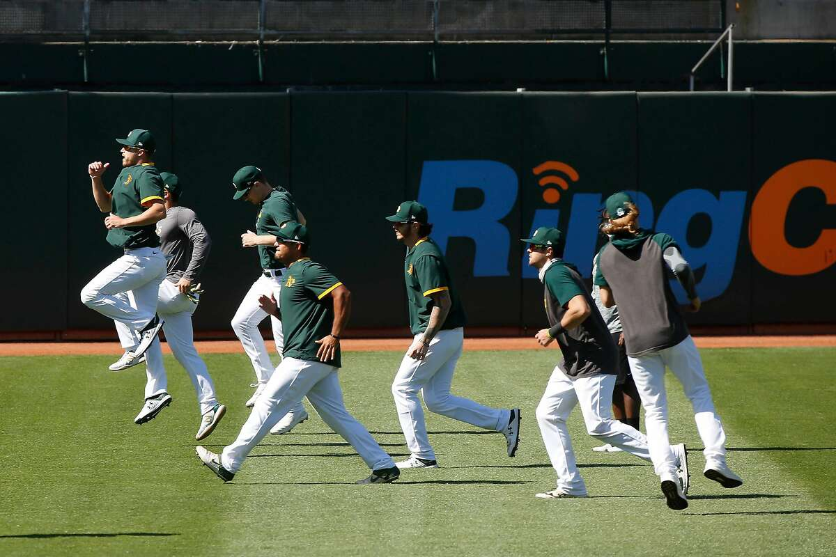 Oakland Athletics' members workout during practice at the Oakland Coliseum on Thursday, July 9, 2020 in Oakland, Calif.