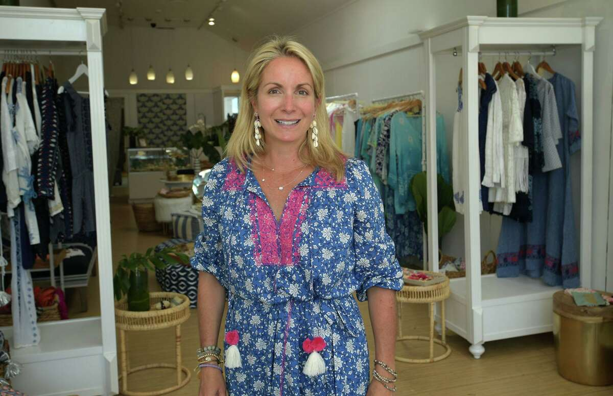 Alison McFerran open her new clothing and accessroies business Hyde Tyde Wednesday, July 15, 2020, in Westport, Conn. New Businessees are opening in town despite the reemergence of COVID-19.