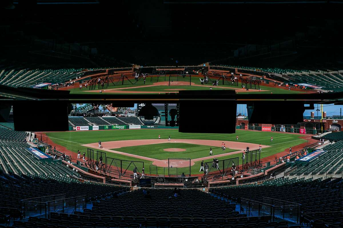 San Francisco Giants are reflected in the media box during Spring Training at Oracle Park on Sunday, July 12, 2020 in San Francisco, California.