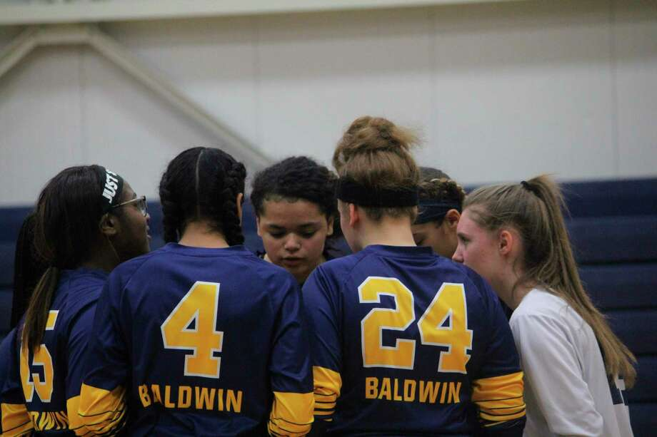 Baldwin volleyball players work on pregame strategy prior to a match last season. (Star file photo)