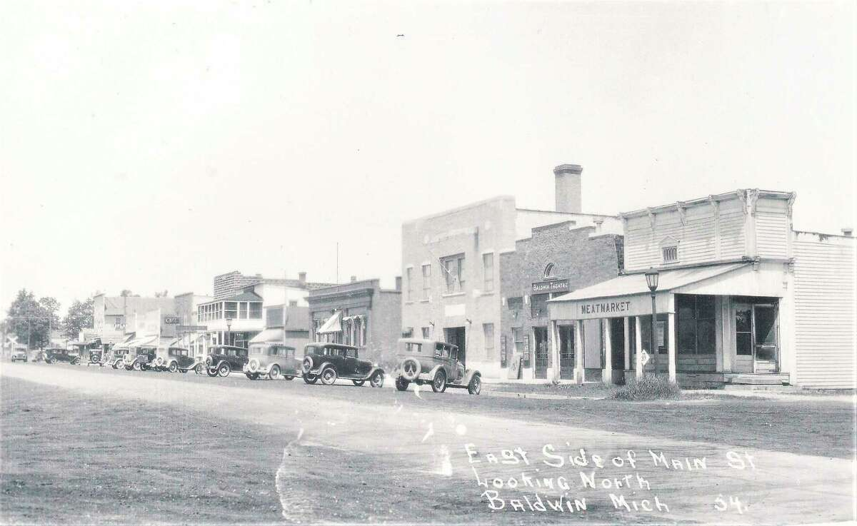 This Lake County Historical Society photo shows the original light pole with the iron birdcage style globe in front of the Feed Store in downtown Baldwin. A similar light pole was recently donated to the Historical Society Museum and has been installed on the museum property. (Submitted photo)