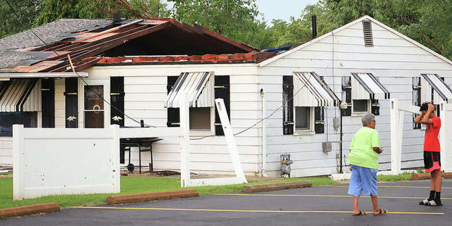 The roof was blown off a house Wednesday evening in the 200 block of East Elm Street in Alton at the height of brief but severe storm around 4:30 p.m. The storm caused widespread damage, with power outages continuing into Thursday morning.