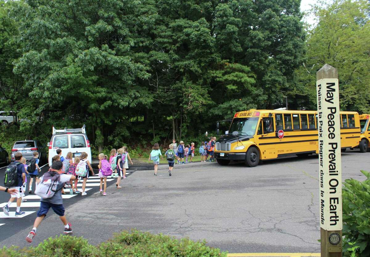 Students board buses after the first day of school on Sept. 1, 2016 at Mill Hill Elementary School in Fairfield, Conn.