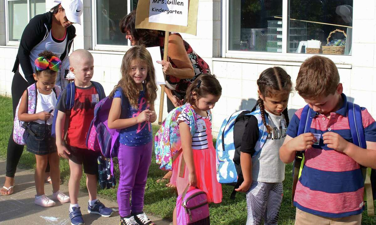 Kindergarteners line up for their first full day of school at McKinley School Thursday. Fairfield,CT. 8/31/17