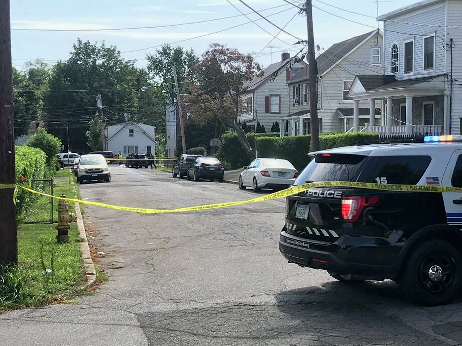 Police are investigating the deaths of two people found in a car parked near the corner of Dale Street and St. Benedict's Circle on Stamford's East Side Thursday morning. Photo: John Nickerson / Staff
