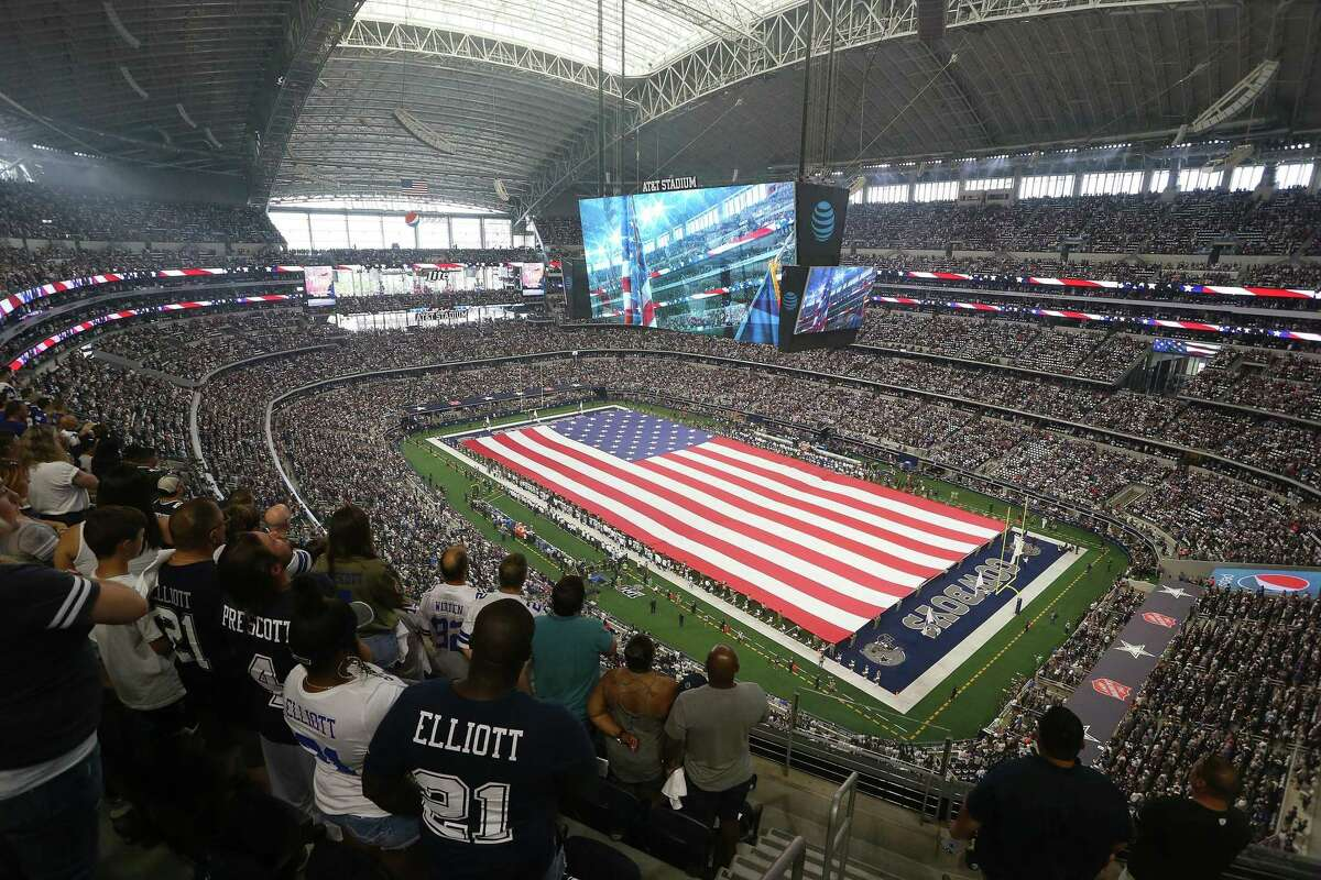 Fans stand during the national anthem as the Dallas Cowboys play host to the New York Giants at AT&T Stadium in Arlington, Texas, on Sept. 8, 2019.