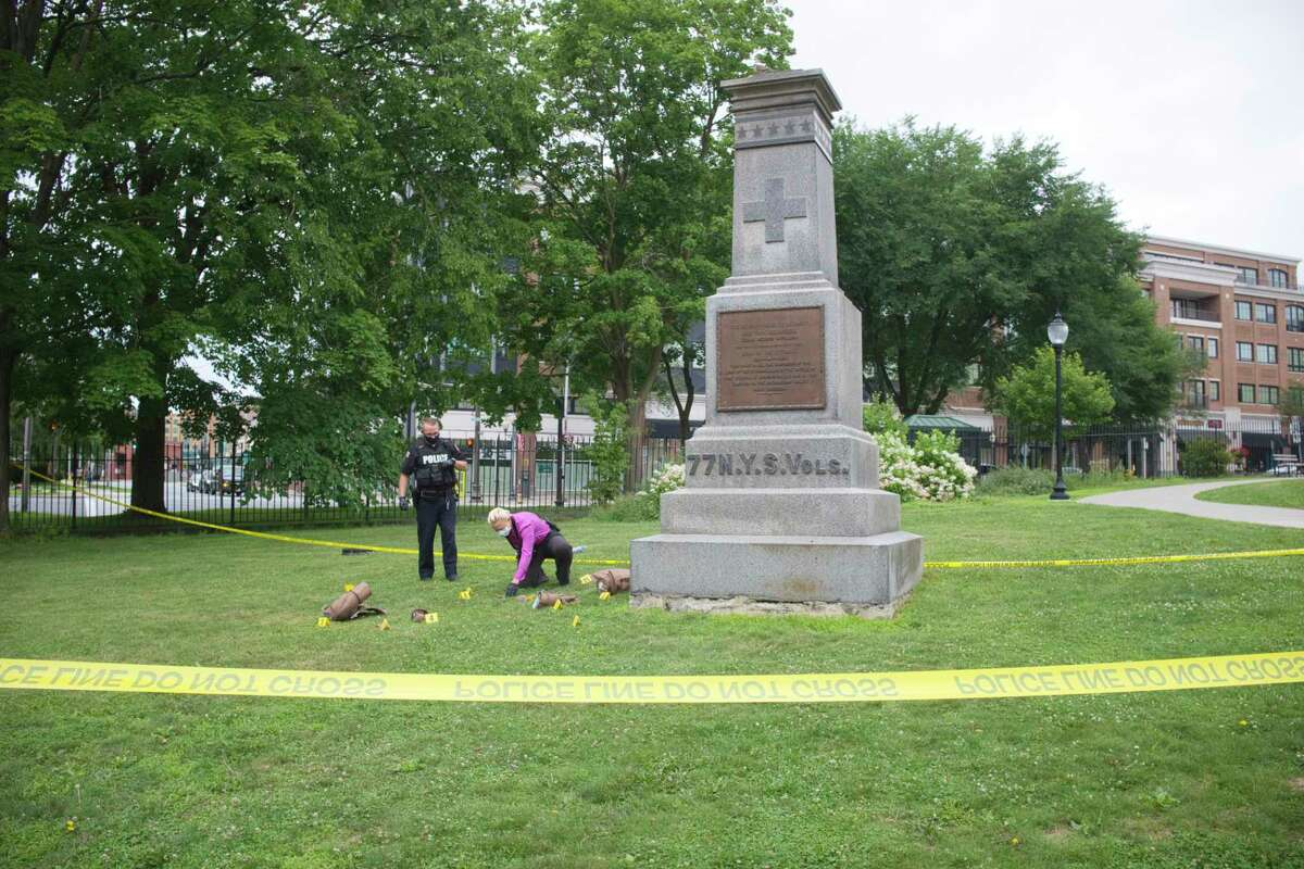 Saratoga Springs Police investigate the smashing of a Civil War statue honoring the Saratoga Regiment which helped the Union Army defeat the Confederacy in Congress Park, on Thursday, July 16, 2020, in Saratoga Springs, N.Y. (Paul Buckowski/Times Union)