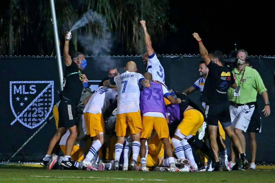 The San Jose Earthquakes celebrate a goal by midfielder Shea Salinas (6) during the second half against the Vancouver Whitecaps at ESPN Wide World of Sports on July 15, 2020 in Orlando, FL. Photo: Peter Casey/Peter Casey-USA TODAY Sports / Peter Casey