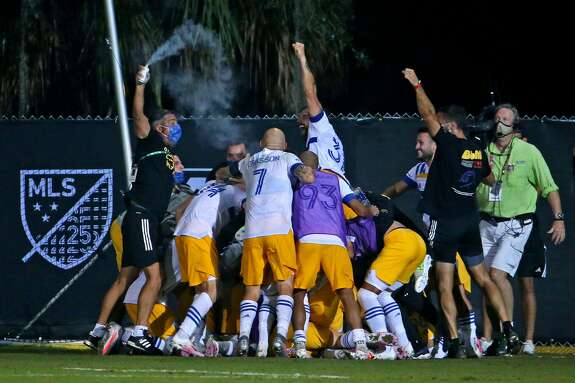 The San Jose Earthquakes celebrate a goal by midfielder Shea Salinas (6) during the second half against the Vancouver Whitecaps at ESPN Wide World of Sports on July 15, 2020 in Orlando, FL.