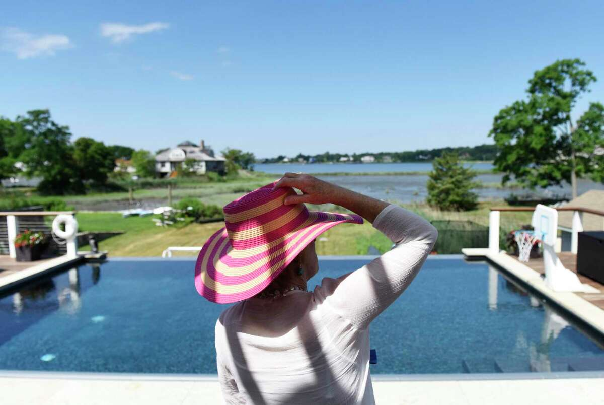 Greenwich Point Conservancy board member Louisa Greene looks at the view from the Feake-Ferris House in Old Greenwich, Conn. during the Founder's Day celebration Wednesday, July 18, 2018.