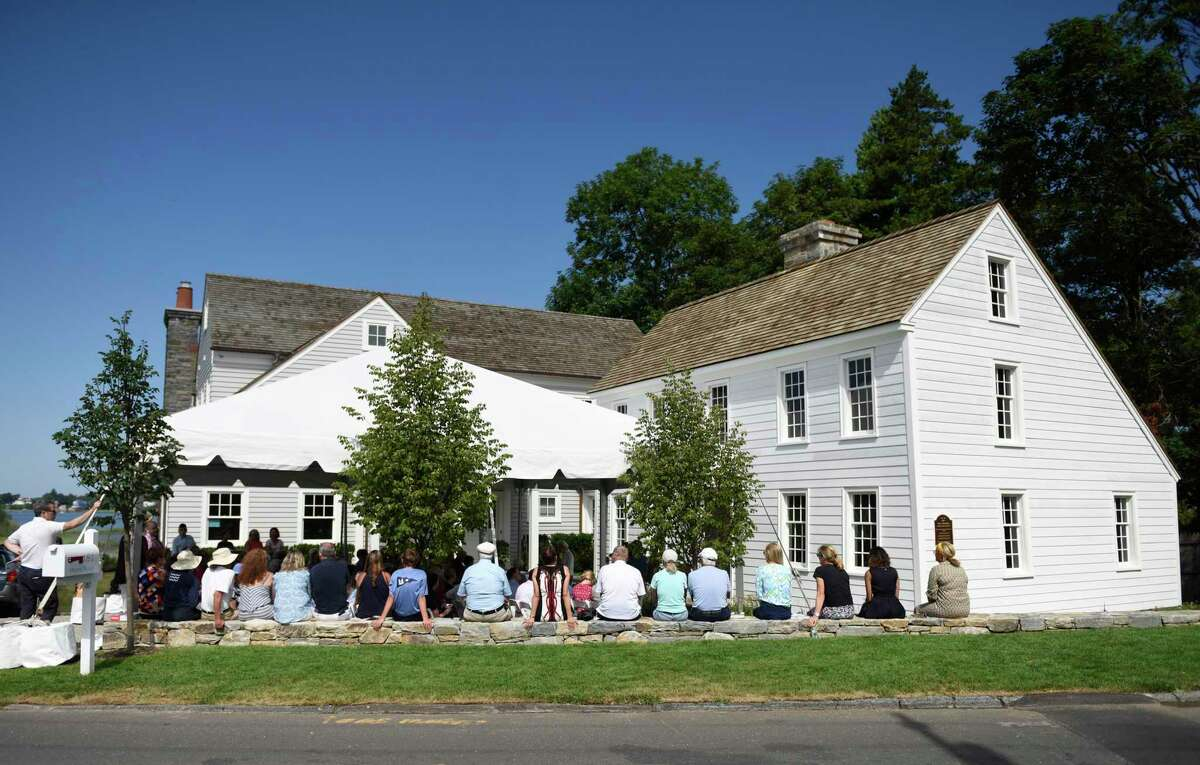 Attendees gather at the Founder's Day celebration at the Feake-Ferris House in Old Greenwich, Conn. Wednesday, July 18, 2018.