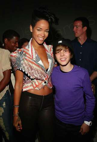 Rihanna and Singer Justin Bieber attend the Island Def Jam Spring Collection party at Stephen Weiss Studio on May 20, 2009 in New York City.  (Photo by Theo Wargo/Getty Images for Island Def Jam) Photo: Theo Wargo / 2009 Getty Images