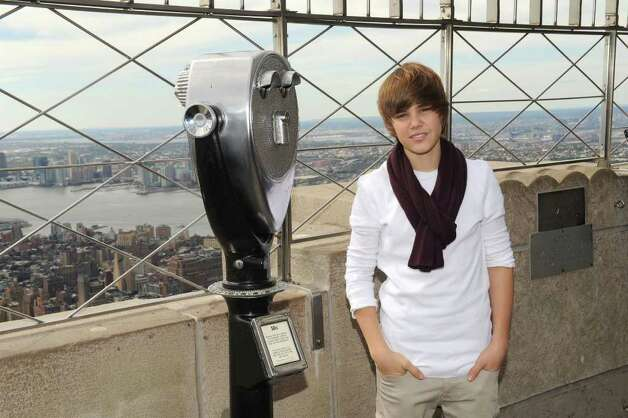 Singer Justin Bieber attends the lighting of the Empire State Building to kickoff Jumpstart's Read For The Record Campaign on October 8, 2009 in New York City.  (Photo by Jason Kempin/Getty Images for jumpstart) Photo: Jason Kempin / 2009 Getty Images