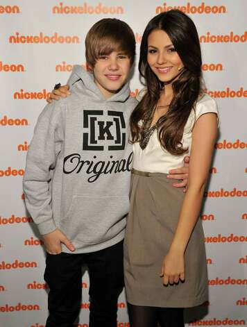 Musician Justin Bieber and actress Victoria Justice attend the 2010 Nickelodeon Upfront Presentation at Hammerstein Ballroom on March 11, 2010 in New York City.  (Photo by Bryan Bedder/Getty Images for Nickelodeon) Photo: Bryan Bedder / 2010 Getty Images