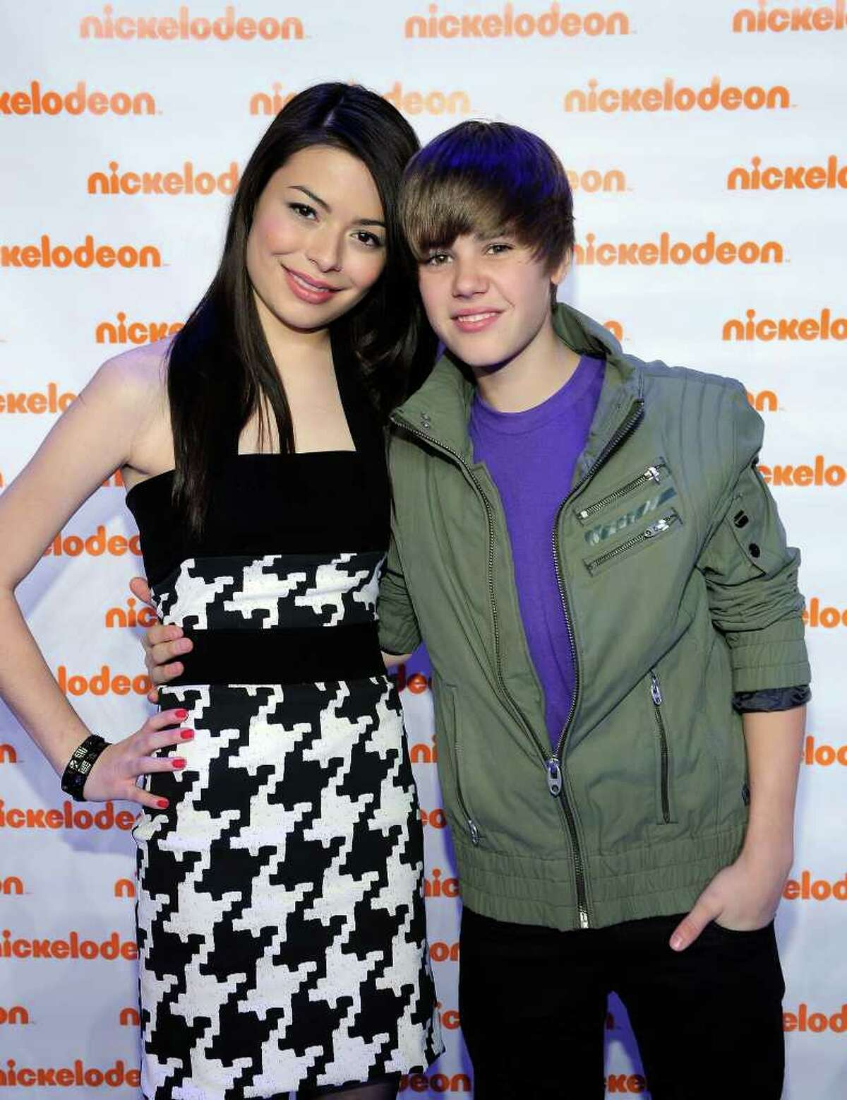 Actress Miranda Cosgrove and musician Justin Bieber attend the Nickelodeon 2010 Upfront Presentation at Hammerstein Ballroom on March 11, 2010 in New York City. (Photo by Larry Busacca/Getty Images for Nickelodeon)